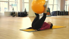 Young woman doing fitness exercise with fit ball. Rostov on Don, Russian Federation - January 05, 2014: Young woman doing fitness exercise with fit ball stock video