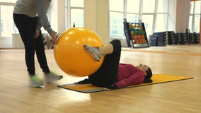 Young woman doing fitness exercise with fit ball. Rostov on Don, Russian Federation - January 05, 2014: Young woman doing fitness exercise with fit ball stock footage