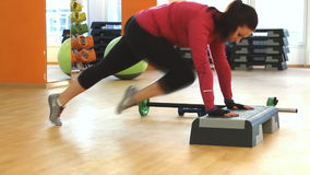 """Young woman doing fitness exercise, Fitness center """"Orange"""". Rostov on Don, Russian Federation - January 05, 2014: Young woman doing fitness stock video"""