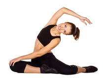 Young woman doing fitness exercises stock images