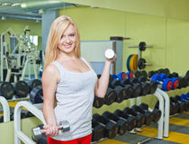 Young woman doing fitness exercises Royalty Free Stock Photo