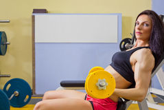 Young woman doing fitness exercises Stock Image