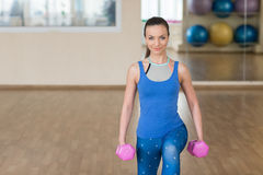Young woman doing fitness exercises with dumbbells Stock Images