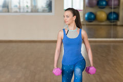 Young woman doing fitness exercises with dumbbells Stock Photography