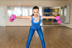 Young woman doing fitness exercises with dumbbells Royalty Free Stock Photo