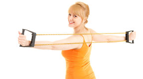 Young woman doing fitness exercises with expander Royalty Free Stock Photos