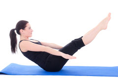 Young woman doing fitness exercises on a mat over white backgrou. Young woman doing fitness exercises on a mat isolated over white background Royalty Free Stock Photos