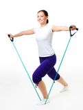 Young woman doing fitness with expander Stock Photos
