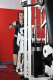 Young woman doing fitness in gym Stock Photo