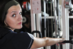 Young woman doing fitness in gym Stock Photos