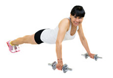A young woman doing fitness. Latin young woman doing push ups isolated over a white background Stock Photos