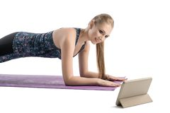 Young woman doing fitness on a mat isolated view Stock Images