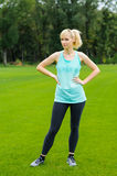 Young woman doing fitness outdoor Royalty Free Stock Photography