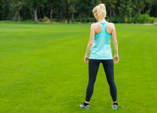 Young woman doing fitness outdoor Stock Images