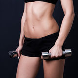 Young woman doing a fitness workout Stock Photos