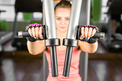 Young woman doing a fitness workout with training apparatus. Athletic young woman doing a fitness workout with training apparatus in a fitness club Royalty Free Stock Image