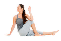 Young woman doing flexibility yoga exercise Stock Images