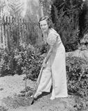 Young woman doing gardening in her backyard Royalty Free Stock Image