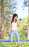 Young woman doing  gym exercises in the park Royalty Free Stock Images