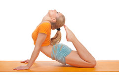 Young woman doing gymnastic exercises Royalty Free Stock Images