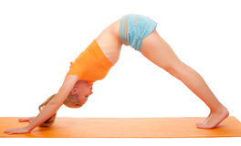 Young woman doing gymnastic exercises Royalty Free Stock Image