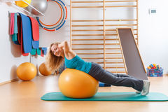 Young woman doing gymnastic exercises Royalty Free Stock Photos