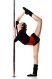 Young woman doing gymnastics against a white Royalty Free Stock Photos