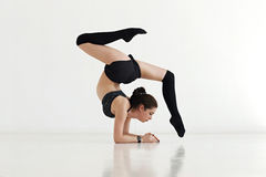 Young woman doing gymnastics or callisthenics Royalty Free Stock Photos