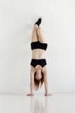 Young woman doing gymnastics or callisthenics Stock Image
