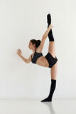 Young woman doing gymnastics or callisthenics Royalty Free Stock Images