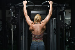 Young Woman Doing Heavy Weight Exercise For Back Stock Photos