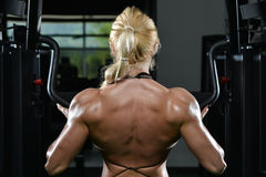 Young Woman Doing Heavy Weight Exercise For Back Royalty Free Stock Photo