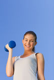 Young woman doing her fitness exercises Royalty Free Stock Image