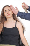 Young woman doing her hair Stock Image