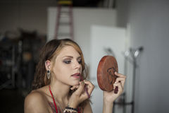 Young Woman Doing Her Makeup Stock Photography