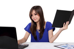 Young woman doing her office work, isolated on white stock photography