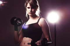 Young woman doing her workout Royalty Free Stock Photos