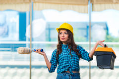 The young woman doing home improvements Stock Photography