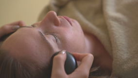 Young woman doing hot stone massage spa. stock video footage