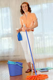 Young woman doing house work Royalty Free Stock Image
