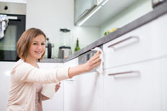 Young woman doing housework Stock Images