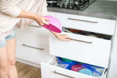 Young woman doing housework Royalty Free Stock Photography