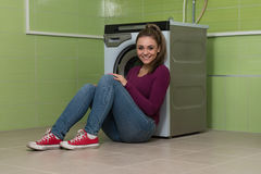Young Woman Doing Housework Laundry Stock Images