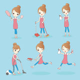 Young woman is doing housework Royalty Free Stock Photo