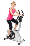 Young woman doing indoor biking exercise. On white background Royalty Free Stock Images