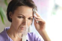Young woman doing inhalation Stock Photos