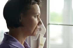 Young woman doing inhalation Stock Photography