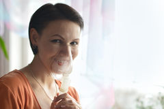 Young woman doing inhalation Royalty Free Stock Image