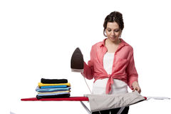 The young woman doing ironing isolated on white Royalty Free Stock Photography