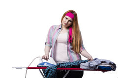 The young woman doing ironing isolated on white Stock Images